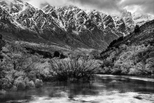 The second day after I arrived in New Zealand it rained in Queenstown. It lasted for about a day and the clouds were thick so visibility was poor. Once the rain stopped and the clouds moved out we were left with a spectacular view of the Remarkables which bordered us on one side. They get their name from the fact that they extend directly north and south which is rather unusual. To get this shot, I stood on a bridge above some rapids on the river and every now and then a speed boat would zoom by over the rapids to the delight of the paying passengers. Looked like a lot of fun.