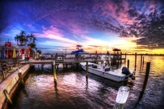 Cortez is a little gem of a fishing village in central Florida. Because it's on the way to the beach thousands of people drive by it every day and never stop. There are several fish markets tucked away which we like stopping into every now and then to pick up fresh catch. There are tree lined streets with quaint houses as well as a little trailer park where winter residents (aka snowbirds) love to come and escape the harsh winters up north. On the evening I took this several of the snowbirds where lined up in lawn chairs with their cocktails along the water to watch the sunset. It lasted for about 30 minutes and as soon as the colors faded they stood up and headed back to their homes. However I noticed  they left their chairs behind so it seems to me they must repeat that ritual each evening. If I ever retire, I might just get a trailer down the road from my house and live the life of a snowbird in the little fishing village of Cortez Florida.