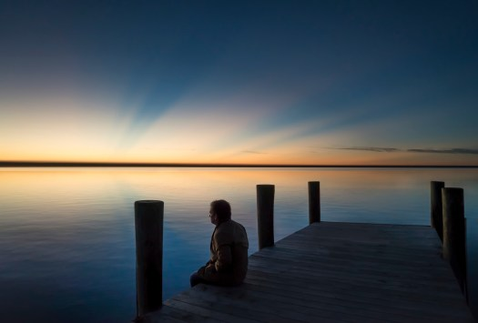 Here I'm sitting on a dock watching the sunrise last year. Everything was quiet and despite the effort to get up early, I was glad to be here. If I could only manage to wake up early a little more often. I love to stay under the covers too much. But then, maybe I'll try again tomorrow.
