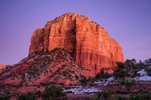 I arrived in Sedona this afternoon and went for a short walk along the bell tower trail. The red rocks were accentuated at dusk to the point that it looked almost too red, almost surreal. The colors, weather and landscape of this place are truly amazing. I once heard that there is suppose some kind of good energy from the earth here.  Maybe I said that wrong, but I can certainly feel something special about this place.  After a few cold days it's warming up and now people seem to be out hiking and enjoying the scenery. Beauty and good energy at every turn, what's not to like?