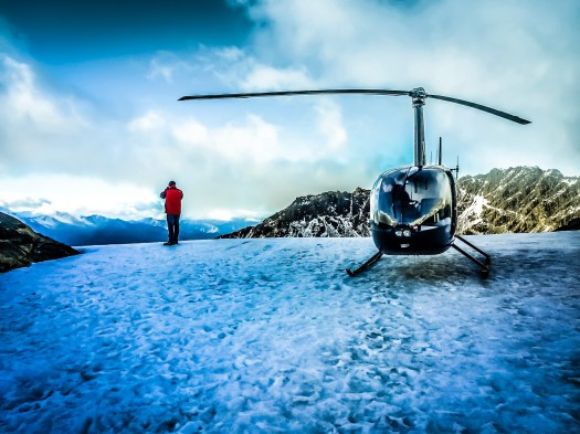 I just found this image on my iPhone. While touring the south island of New Zealand by helicopter I must have taken my iPhone out at some point to capture the moment. As I recall this was on top of a Glacier that sloped down and that the ice was quite slippery. I took this and then walked a little beyond where my friend was standing and then realized that if I slipped there was no way to self arrest. That's when I began taking baby steps backwards until I felt I was no longer in danger. As long ago as this was, I remember it like it just happened.