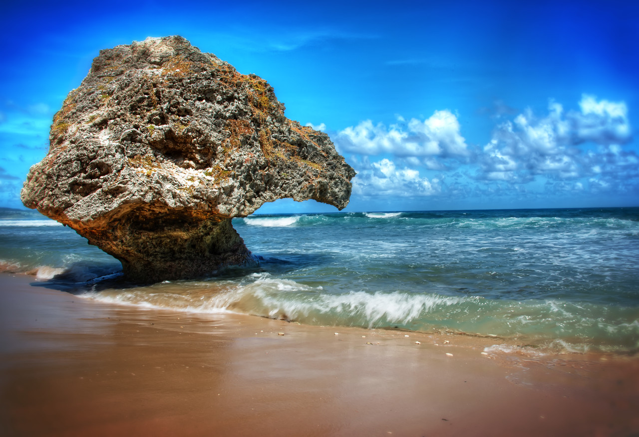 In Saint Joseph Parish in Barbados is Bathsheba Park and along the beach are these rocks eroded by the waves at the bottom. Water is one of the most powerful forces on the planet yet you can put your hand in it, swim in the warm waters of the tropics, take a shower, and it all seems so harmless. I think it's one of those things that's hard to fathom until you experience it's force first hand. Reminds me of Niagara Falls, until you see it for yourself you really can't imagine. But back to Barbados, the waters here seemed perfectly harmless, warm and inviting and the only force I was feeling was urge to take a nap in the shade.