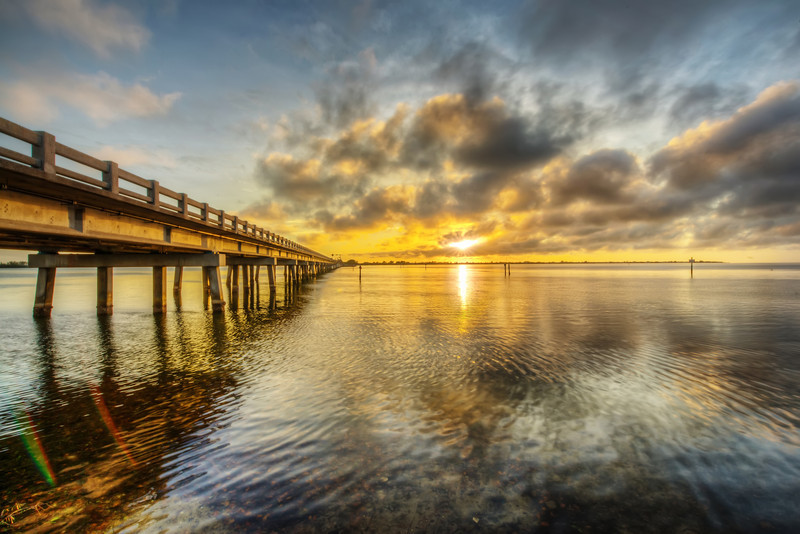 I took this while driving to the beach to photograph the sunset. In Bradenton, you  cross this bridge to get to Anna Marie Island and Holmes Beach. When the tide is moving, the bridge is full of fishermen. It's my understanding that the fish move with the tide, but then don't take my word for it, fishing is not one of my stronger suits. That's a polite way of saying I suck at fishing. Nonetheless, I like to fish on occasion, even if I end up buying my fish from the grocery store.