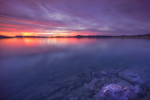 Another sunset from earlier this year at Lake Pleasant just north of Phoenix. It's a good sized reservoir for being out in a desert. In any case, I  lucked out this on this evening when the water was calm and the clouds perfect. Pleasant indeed.