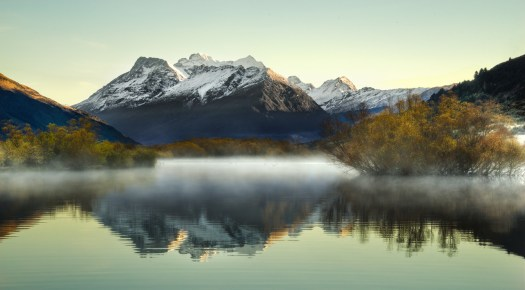 Imagine, if you will, walking along a misty frozen swamp just after sunrise, surrounded by snow capped peaks. Occasionally the silence is broken by the call of black swans as the establish they're presence in the valley. This is not a fiction of my imagination, this is the scene at Glenorchy this morning. As I was immersed in this magical landscape I couldn't help but wonder how such a place could exist in our modern world. But it does, right here on the southern island of New Zealand.