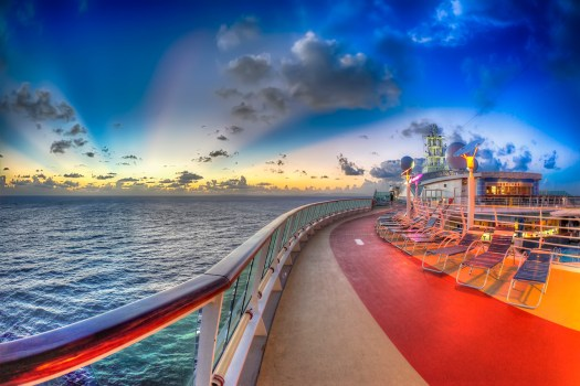 On the last day of our journey aboard the Jewel of the Seas I got up before sunrise to capture a few pictures around the ship. This is the top deck and running track which overlooks the pool area. In a couple of hours this would be full of folks catching some rays or enjoying water volleyball. But in the tranquility of the morning the sun rose behind a layer of clouds and cast these rays that I was lucky enough to capture. The cruise season is in full swing now and I suspect the economies of many Caribbean ports of call are doing quite well right about now.