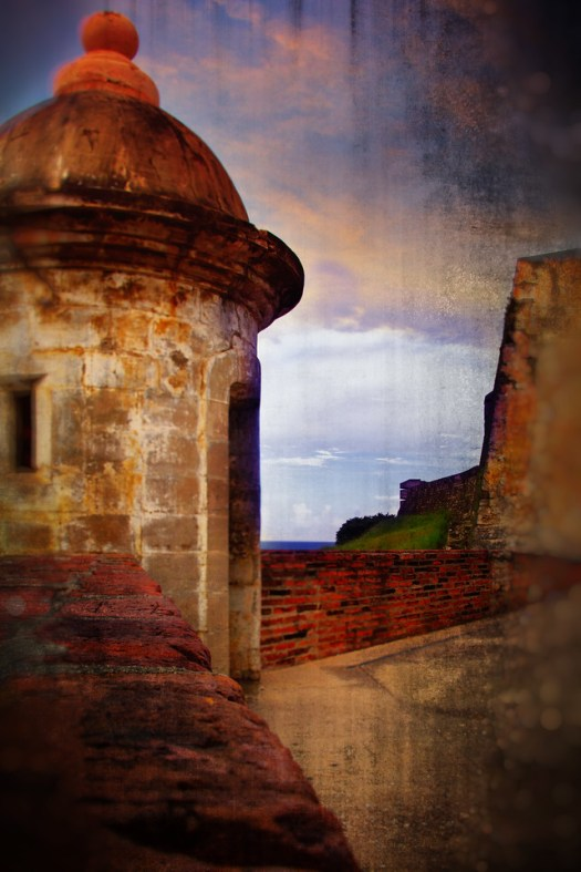 A couple of weeks ago I was walking around the old fort in San Juan, Puerto Rico. You couldn't go inside because the park service was closed due to the federal government shutdown. Since the fort was shut down there police at all the gates, guarding the fort. It was a little ironic and a little bit of a flashback to a few hundred years ago when there would be guards at the gate also, probably on the inside though dressed somewhat differently. Despite the guarded fort, it's a nice walk along the outside. This is one of the many iconic lookouts that line the walls. As far as I know, the fort wasn't attacked this day.