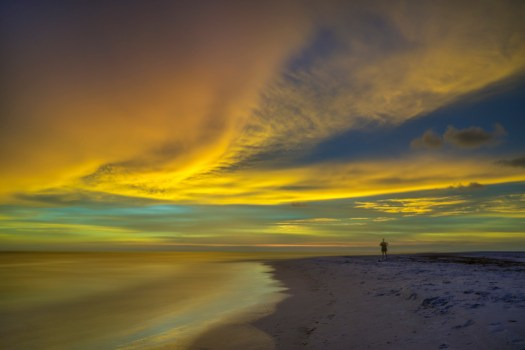 This was the scene a few hours ago at Ledo Beach in Sarasota Florida. After the sun went down it illuminated these clouds with a peachy yellow glow. It had the effect of a lantern, making everything brighter. A phenomenon I'd not seen before that lasted for about fifteen minutes.  Anyway, I was fortunate to see it and have my camera ready. From what I could tell, the other people on the beach were just as amazed as I was.