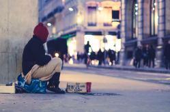 Homeless man on street corner