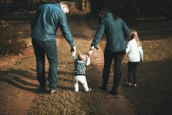 family walking on a path