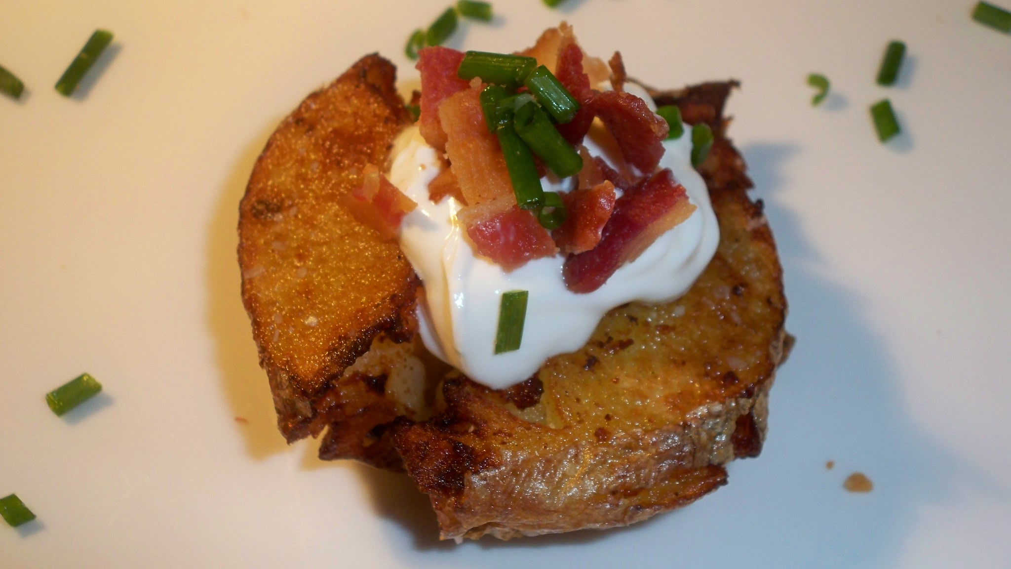 Potatoes Topped with Sour Cream, Bacon & Chives