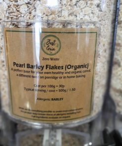 Organic pearl barley flakes dispenser in the plastic free snacks and treats section Just Gaia zero waste grocery in Halifax, West Yorkshire