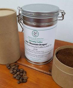 "Chinese speciality coffee ""Mountain Dragon"" on display at Just Gaia Halifax, showcasing tins and paper pots for the fresh beans and ground coffee options. All plastic free."