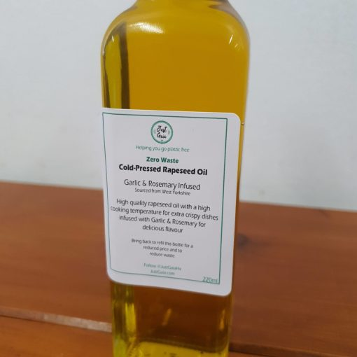 Our Just Gaia cold pressed oils. Zero waste rapeseed oil infused with rosemary and garlic close up.