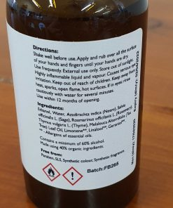Natural hand sanitiser spray in Just Gaia showing reverse of the glass bottle and non drying spray as part of the PPE range