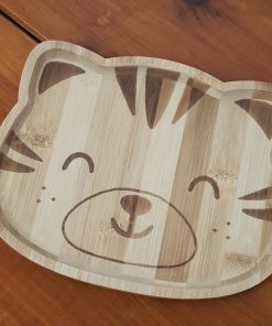 Bamboo children's plates (Tiger shape close up) on display in Just Gaia Halifax.