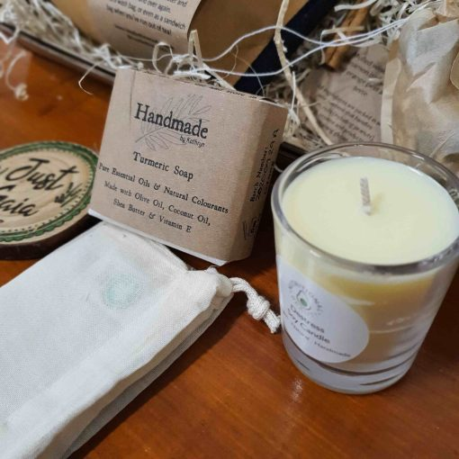 Close up of soy candle and turmeric soap in Luxury Bathroom Pamper Gift Set at Just Gaia, UK
