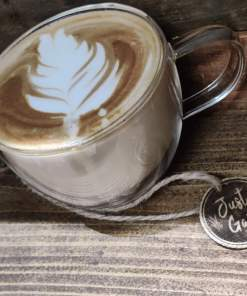 Image of a coffee at Just Gaia for collection flat what, latte, cappuchino, americano or others available.