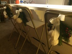 Styrofoam balls covered in yarn and tied to faux evergreen brances