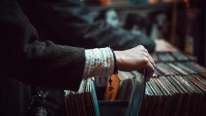 Another picture of a person shopping for unwarped records at a record store.