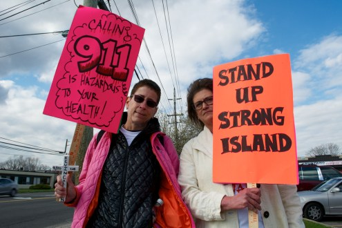 Protesters with signs. Annual Anti-Police Brutality March in Long Island, NY, Bay Shore, April 13th, 2013.