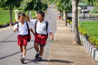 Two boys walking home from school