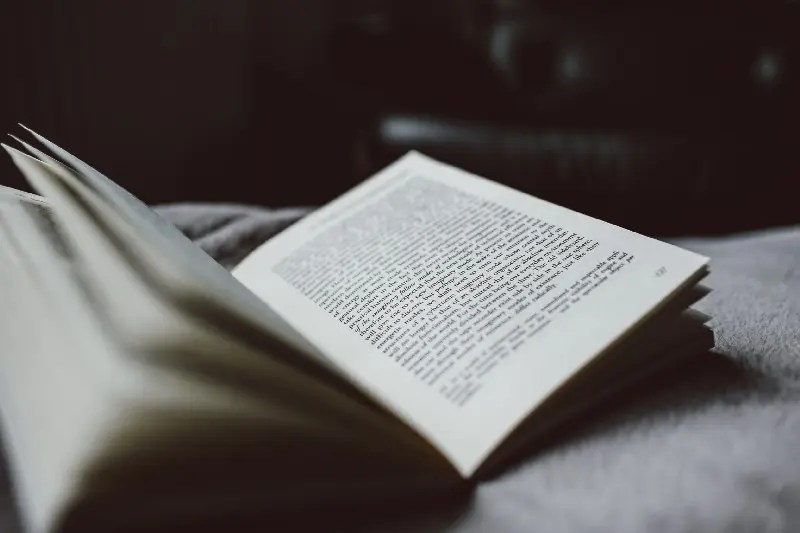 """""""selective focus photography of opened textbook"""" by James Bold on Unsplash"""