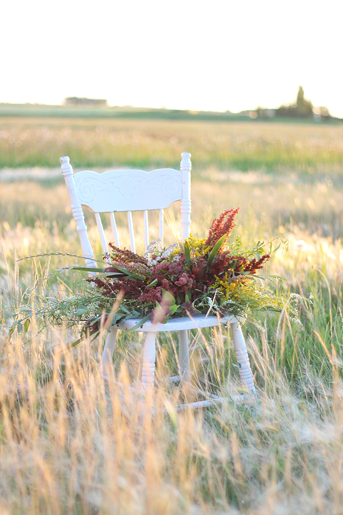Foraged Prairie Wildflower Bouquet on a White Antique Chair in a Field | Calgary, Alberta, Canada // JustineCelina.com