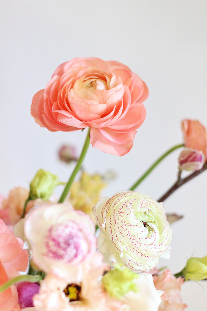 A Blushing Spring Arrangement with Coral Japanese Ranunculus | Spring Wedding Flower Ideas | Pantone Colour Trends Spring 2017 // JustineCelina.com
