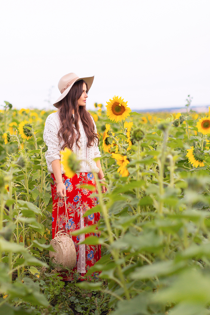 Autumn 2018 Lookbook | How to Style Maxi Dresses for Autumn | Girl wearing a maxi dress and hat in a sunflower field at the Bowden Sunmaze at Sunset, Alberta, Canada | Calgary Lifestyle Blogger | Autumn 2018 Trends | JustineCelina.com
