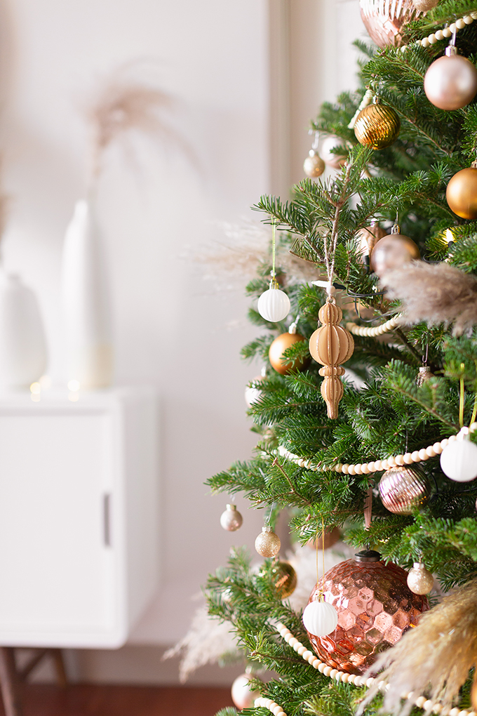 Apartment Friendly Modern Holiday Decor   Real Christmas Tree with Wood Garland, Metallic and Wood Ornaments and Pampas Grass   Premium Nova Scotia Balsam Fir Tree   Bohemian, Mid Century Modern Holiday Decot   Bohemian Holiday Home Tour 2018   Canadian Tire CANVAS Ornaments // JustineCelina.com
