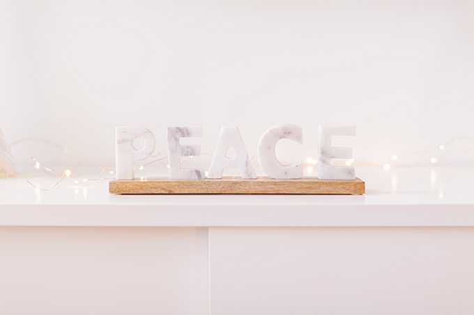 Apartment Friendly Modern Holiday Decor   Balsam & Fir Marble PEACE Sign   Bohemian, Mid Century Modern Holiday Decor   Bohemian Holiday Home Tour 2018   Caramel Mid Century Modern Leather Couches // JustineCelina.com