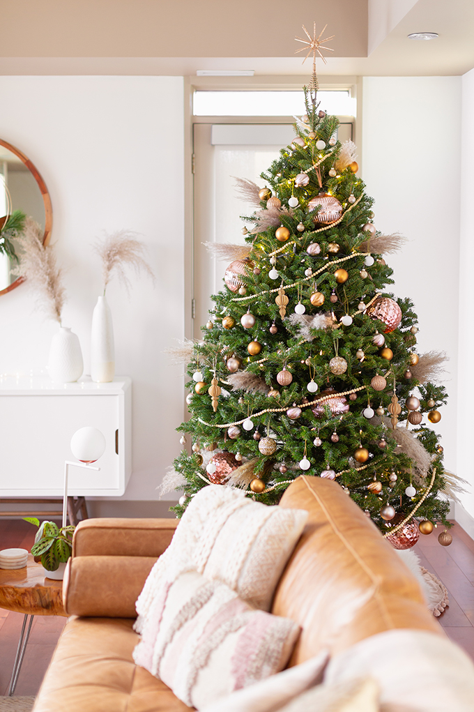 Apartment Friendly Modern Holiday Decor | Real Christmas Tree with Wood Garland, Metallic and Wood Ornaments and Pampas Grass | Premium Nova Scotia Balsam Fir Tree | Bohemian, Mid Century Modern Holiday Decor | Bohemian Holiday Home Tour 2018 | Caramel Mid Century Modern Leather Couches | Canadian Tire CANVAS Ornaments // JustineCelina.com