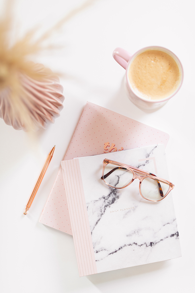 2018 Review + 2019 Goals | Calgary Lifestyle Blogger | 2019 Planning and Goal Setting | Entrepreneur Working from Home | HomeSense Fringe This Girl Can 2019 Agenda | STIL Classics Daily 6 Month Planner |  Nespresso Coffee on a White Coffee Table | 2019 Motivational Goals Flatlay | Bonlook Lauren Blue Light Blocking Glasses In Peach // JustineCelina.com