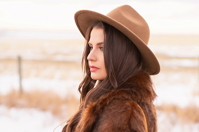 Pre Spring 2019 Trend Guide Bohemian Rhapsody: How to Style Midi Dresses for Transitional Spring Weather   Brunette Girl Standing in a Country Field at Sunrise Wearing a Brown Faux Fur Coat and Brown Wide Brim Hat   Bohemian Early Spring Style Ideas   Pantone Spring Summer 2019 Fashion Ideas   Calgary, Alberta, Canada Fashion & Lifestyle Blogger // JustineCelina.com