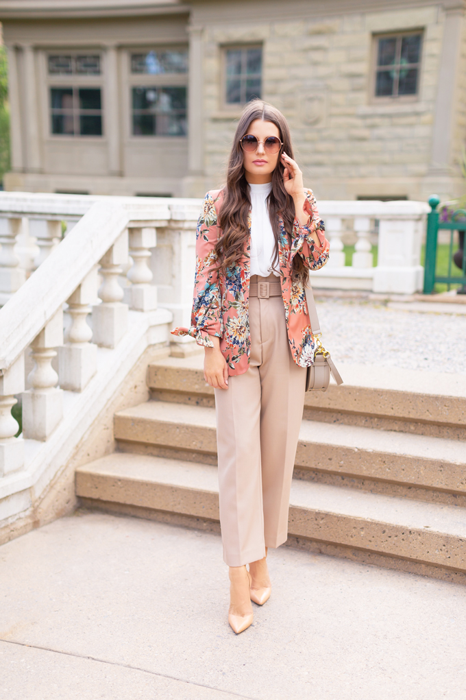 SPRING/SUMMER 2019 LOOKBOOK | Khaki Chic: How to Style Paperbag Pants at the Office for Spring | Paperbag Pant Outfit Ideas | Professional Spring/Summer 2019 Outfits | Brunette woman wearing high waisted khaki paperbag pants, a white top, a coral floral blazer, nude pointed toe pumps and Artisan Anything's Chloe Tess dupe in grey | How to Wear the Paperbag pant Trend for SS19 | Top Spring/Summer 2019 Trends | Calgary Fashion Blogger // JustineCelina.com