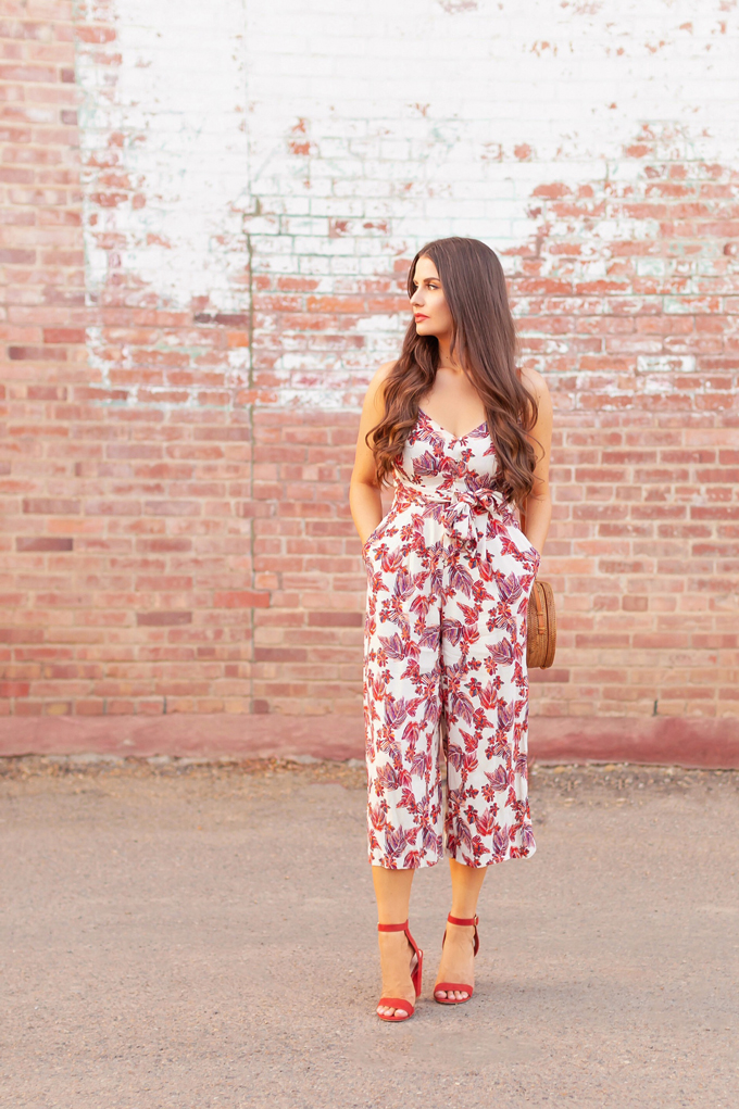 LATE SUMMER 2019 LOOKBOOK | Hot Tropic: How to Style Jumpsuits for Transitional Weather l Summer/Fall 2019 Casual Outfit Ideas | How to Wear The Pantone Autumn/Winter 2019/2020 Fashion Color Trend Report | How to Style Tropical Prints for Summer 2019 | Brunette woman wearing a Free People Tropical Print Jumpsuit, Burnt Orange Block Heel Sandals and a Bali Round Woven Bag | Top Summer to Fall 2019 Transitional Trends and how to wear them | Calgary Fashion Blogger // JustineCelina.com