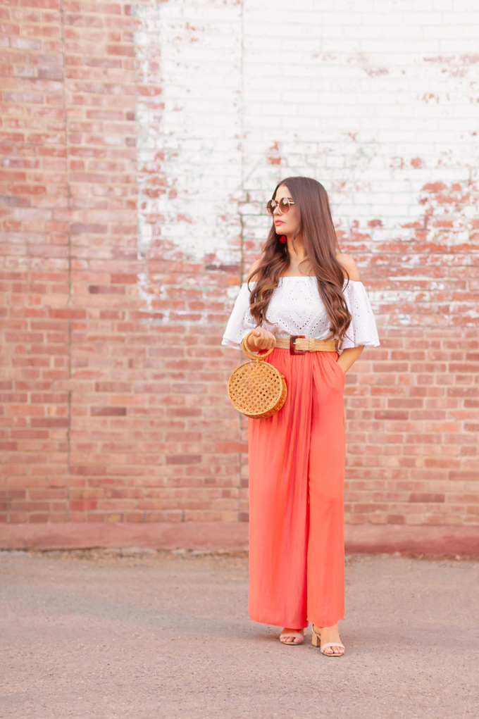 LATE SUMMER 2019 LOOKBOOK | Living in Coral: How wear Pantone's 2019 Colour of the Year, Living Coral for Summer / Autumn 2019 l Summer/Fall 2019 Casual Outfit Ideas | How to Style Palazzo Pants for Summer / Fall 2019 | Brunette woman wearing Coral Palazzo Pants, a white Broderie Anglaise off-the-shoulder top, a bamboo bracelet bag and a woven tortoise buckle belt | Top Summer to Fall 2019 Transitional Trends and how to wear them | Calgary Fashion Blogger // JustineCelina.com