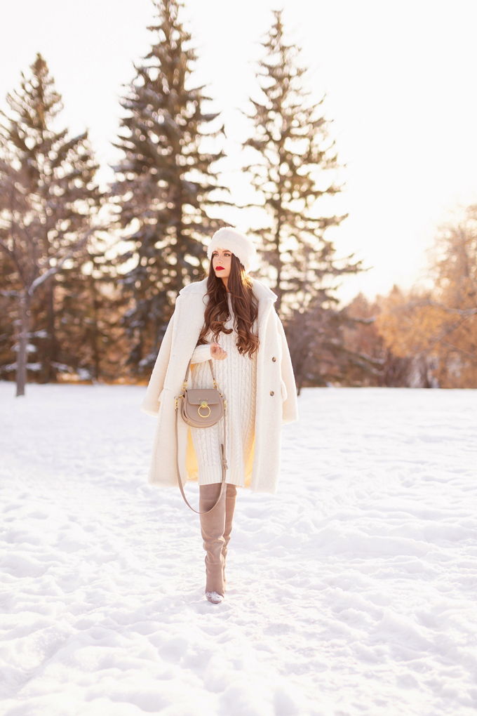 Autumn / Winter 2019 Lookbook: Winter Whites | Top Fall / Winter 2019 / 2020 Trends | Top Winter 2019 Trends and How to Wear Them | Brunette woman wearing a Mango Oversized Cream Teddy Coat, Cream Cable Knit Sweater Dress, Grey Over The Knee Boots and Grey Chloe Tess Dupe | Monochromatic Cream / White Outfit | Festive Winter Holiday Outfit | Christmas Dinner Outfit | Canadian Winter Outfit Ideas | How to Style a Faux Fur Headband | Top Calgary Fashion & Lifestyle Blogger // JustineCelina.com