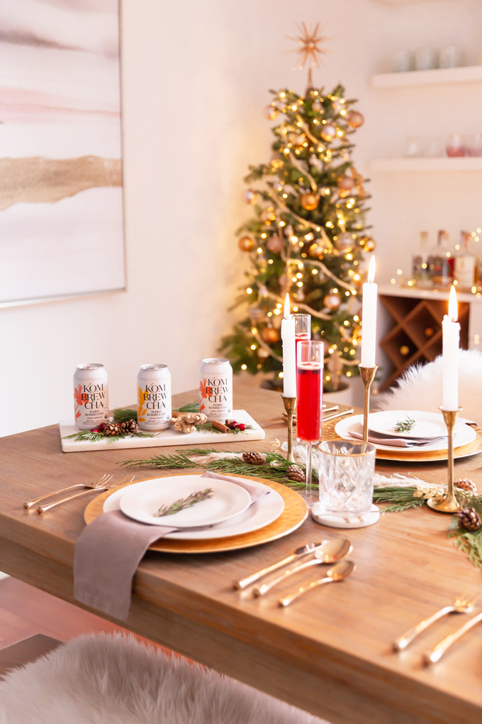 Easy Holiday Entertaining Ideas | Holiday Entertaining at Home | Stress Free Entertaining Tips | Holiday Cocktail Party | Easy Christmas Party Ideas | Simple Mid Century Modern Holiday Dinner Party | JustineCelina's Mid Century Modern Bohemian Dining Room & Bar | Simple Festive Tablescape with Winter Greenery, Pampas Grass, Candles and Berry Hibiscus & Royal Ginger Kombrewcha | Kombrewcha available in Alberta | Kombrewca Review | Calgary Home Decor & Entertaining Blogger // JustineCelina.com