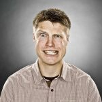 Justin Jackson's professional headshot, taken in Edmonton, Alberta, Canada