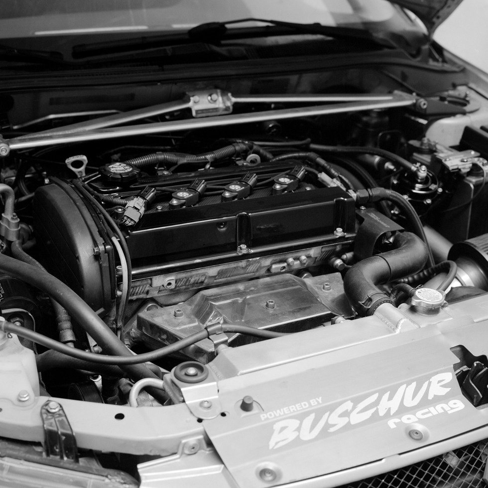 The dirty engine bay on the Evo