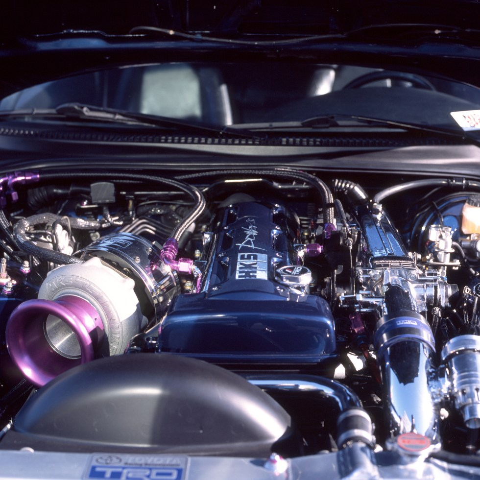 Toyota Supra Mk4 engine bay with a lot of shiny HKS upgrades