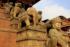 Parade of Statues outside a temple - Bhaktapur, Nepal