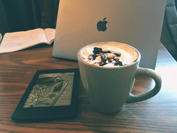 Reading my Kindle in a Cafe
