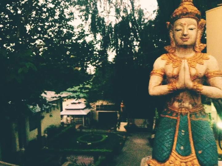 Turquoise and gold Buddha statue at Doi Suthep