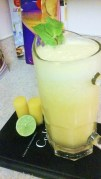 FRESH PINEAPPLE JUICE WITH GINGER ROOT, ORANGE, LIME