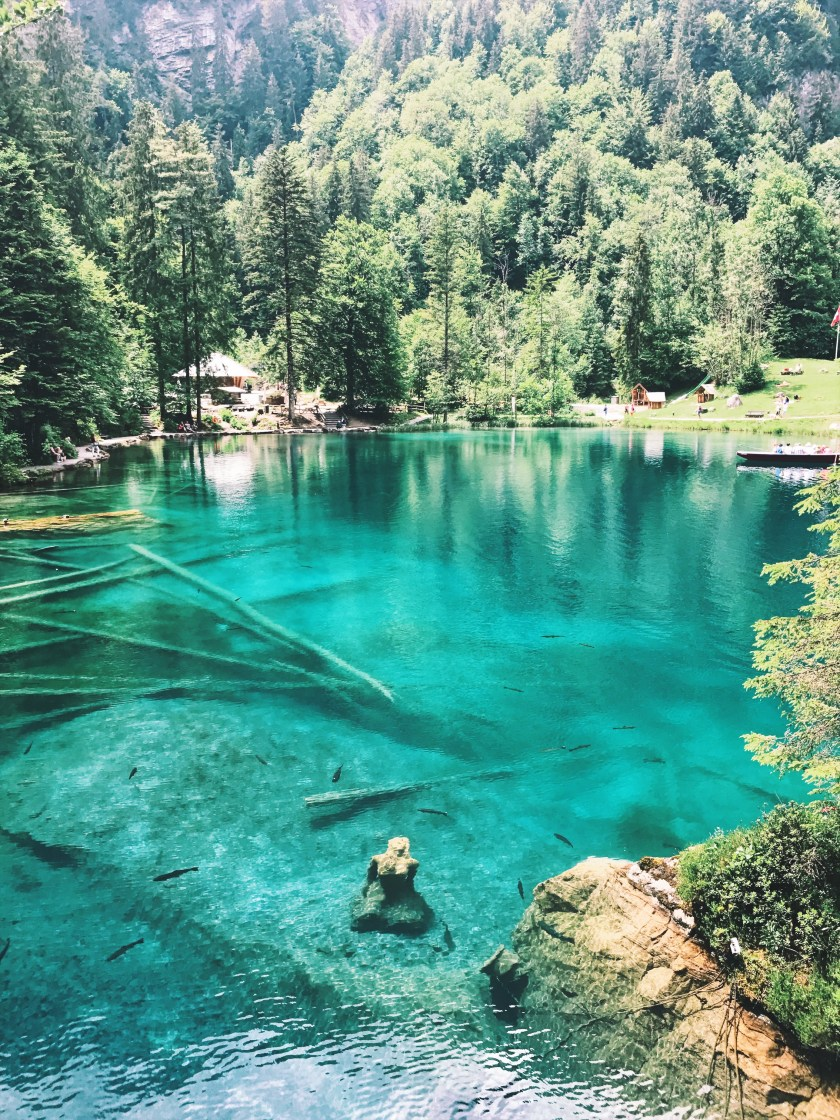 Blausee statue and color of water, Alps, Switzerland