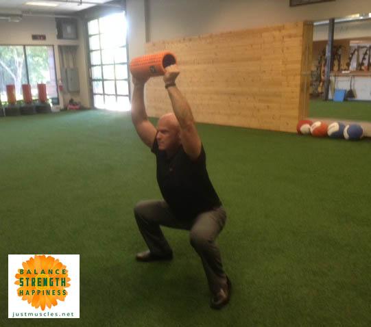 Image of Matt Hemsley doing an overhead squat.