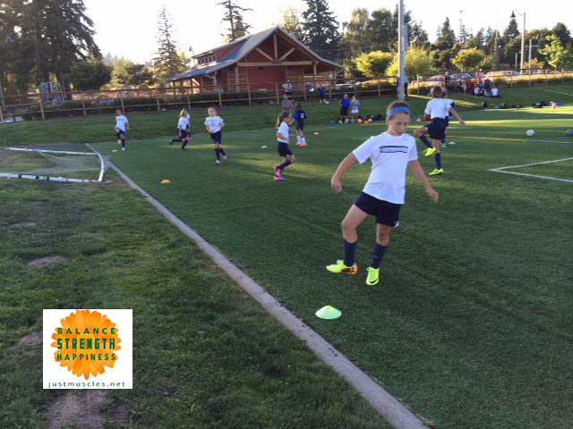 Image of girls moving during soccer warmups